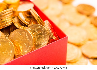 gold coins in red box