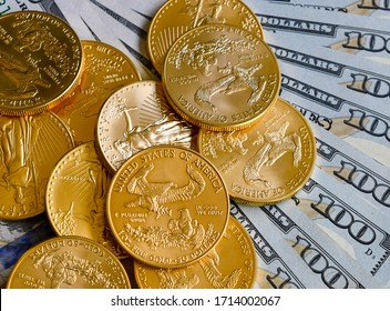 Gold coins with US dollar currency notes