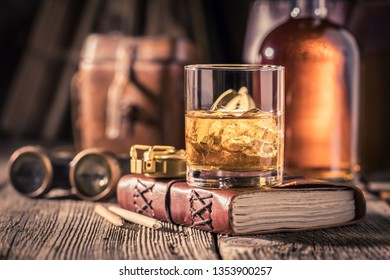Gold and cold whisky with ice and golden bottle