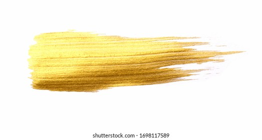 Gold color brush stroke isolated on white background.