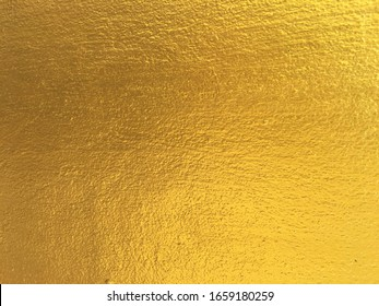 Gold color cement wall texture background design