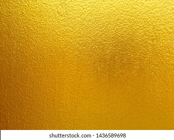 Gold color concrete wall background for texture