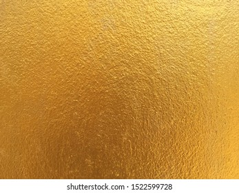 Gold color concrete wall background and texture