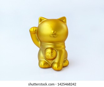 Gold color lucky cat, (Maneki Neko) Isolated on white background. (Japanese word means fortune)
