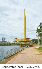 Gold color monument named Millennium Monument in Putrajaya, Malaysia.