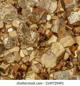 Gold color pyrite cubes macro shot