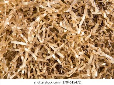 Gold color shredded paper - gift box filler background.