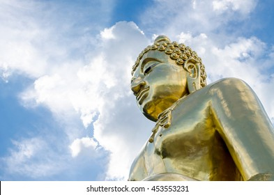 Gold color Statue in thai temple over blue sky