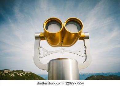 Gold color tourist binoculars working with money