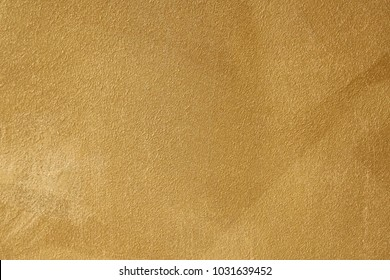 Gold color wall with grainy texture pattern