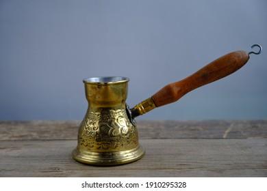 Gold colored metal coffee mug