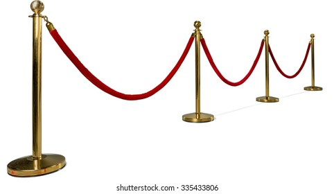 Gold colored metal stanchions with red velvet rope for crowd control