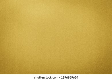 Gold colored paper with a shimerring finish texture. Gold paper texture