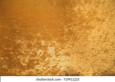 Gold colour velvet fabric background texture