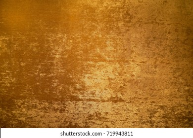 Gold colour velvet fabric background texture