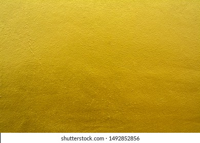 Gold concrete wall background, Gold pattern of cement floor