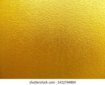 Gold concrete wall background for texture abstract