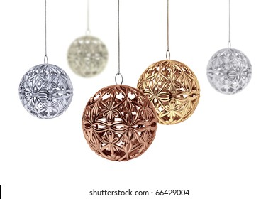 Gold copper silver Christmas balls hanging on white background