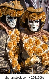 Gold costume with golden roses at the Venice Carnival