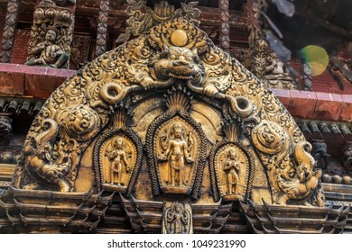 gold craft of goddes in hinduism sculpted on archway that according to belief of Nepali people for guarding the door and preventing evil enter temple.