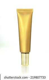 Gold cream Cosmetics bottle on White background