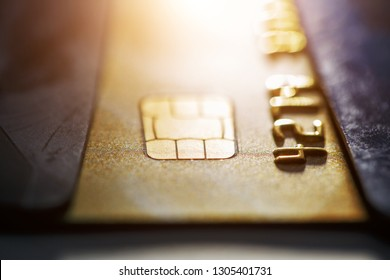 Gold credit card with micro chip selective focus. Macro shooting with a credit card. Selective focus microchip on paying by credit card or debit card for background. contactless payments