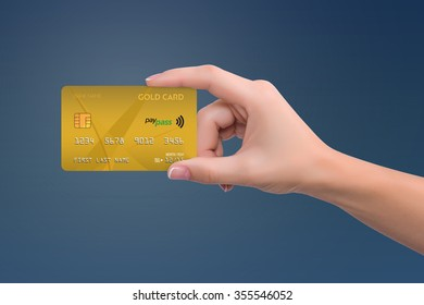Gold credit card in woman hand on blue background