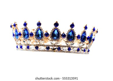 Gold crown with blue jewel of precious stones.