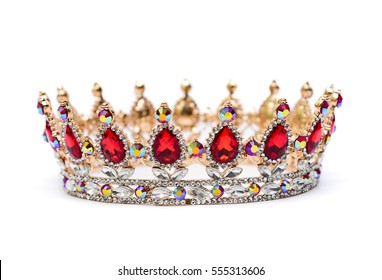 Gold crown of queen with red and white jewel of precious stones.