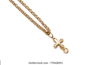 Gold crucifix isolated on white