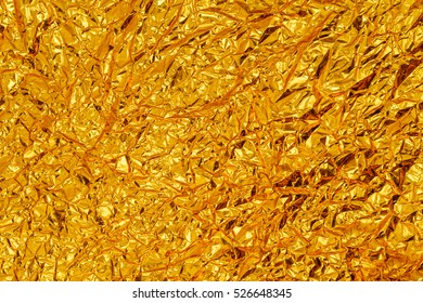GOLD crumpled shining paper Texture background With Copy Space foe your text