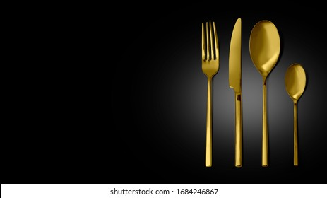 Gold cutlery set with Fork, Knife and Spoon isolated, with clipping path