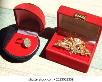 gold decorated with sparkling diamonds even though some of the stones are missing it still looks luxurious