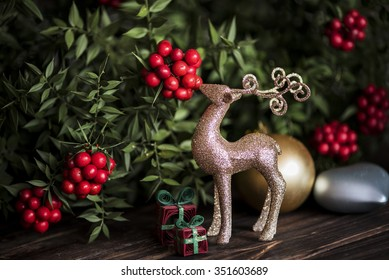 gold deer with christmas tree