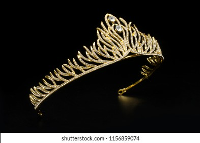 gold diadem with diamonds isolated on black