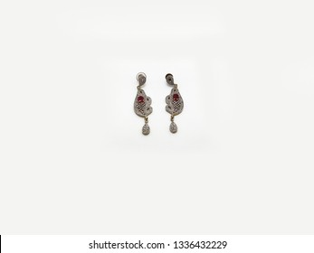 Gold and Diamond earrings jhumka isolated on white background