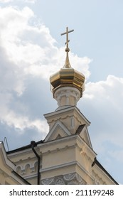 Gold domes and cross of an orthodox church in kharkiv