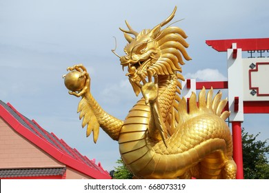 The gold dragon is angry in Thai temple