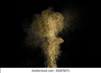 Gold dust glitter shooting on black background