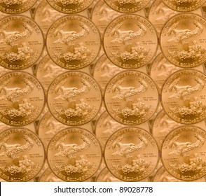 Gold Eagle one ounce coins in a patterns and stacked on each row