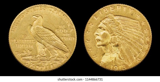 gold eagle two and a half dollar 1913 US coin with indian head isolated on black background