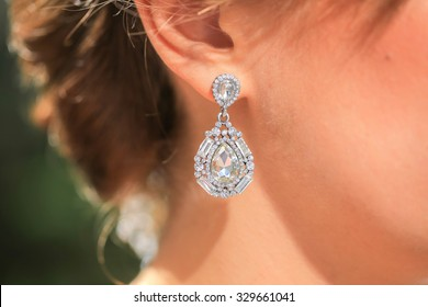 Gold earring with diamond. Diamond earring. Jewelry earring.