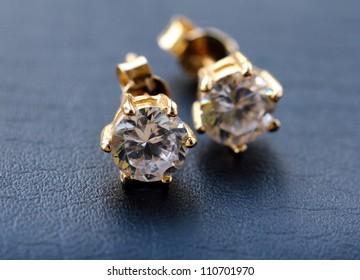 gold earrings with diamonds macro shot