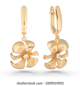 Gold earrings on white background.