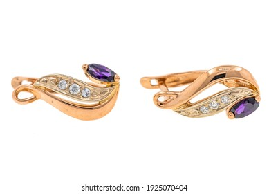 Gold earrings with purple stones