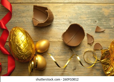 Gold easter egg with broken chocolate pieces