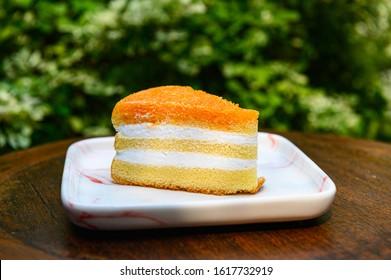Gold egg yolk thread cake on the table.