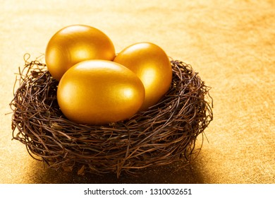 gold eggs on a nest on a golden background