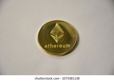 Gold ethereum ethereal  coin on white background.