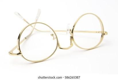 gold Eye Glasses Folded Isolated on White.